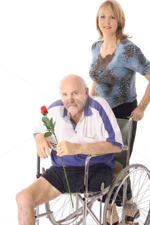 Beautiful daughter pushing her elderly father stock photo, Beautiful daughter pushing her elderly father by Andi Berger