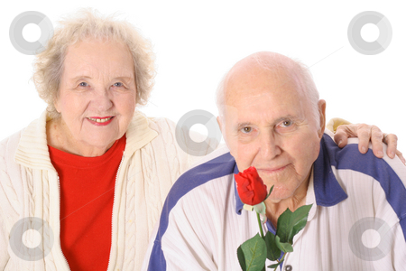 Senior couple with a beautiful rose stock photo, Senior couple with a beautiful rose by Andi Berger