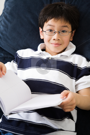 Studying student stock photo, A shot of an asian kid studying at home by Suprijono Suharjoto