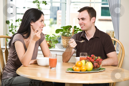 Couple eating breakfast stock photo, A shot of a couple eating their breakfast at home by Suprijono Suharjoto