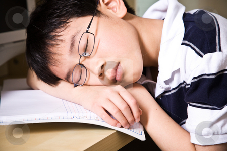 Sleeping young student stock photo, A shot of an asian student falling asleep while studying at home by Suprijono Suharjoto