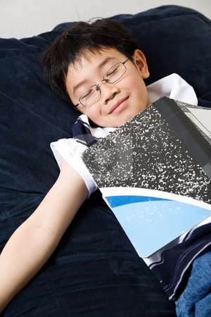 Sleeping young student stock photo, A shot of an asian kid sleeping while studying at home by Suprijono Suharjoto