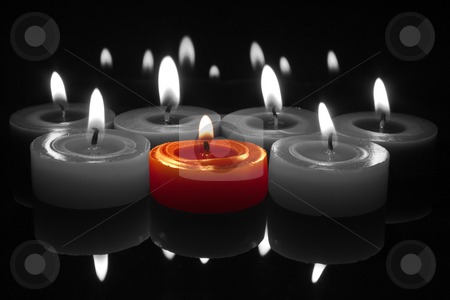 Red candle with flame on black and white stock photo, Glowing flames from centre red candle with reflections top and bottom by Stephen Clarke