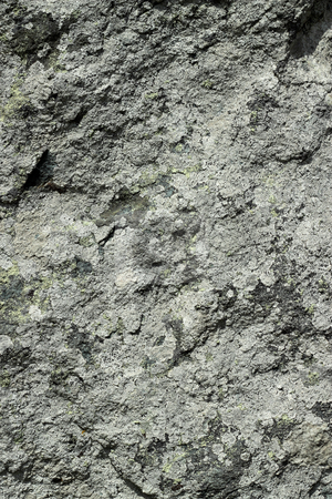 Rough dark gray granite rock texture natural background. stock photo, Rough dark gray granite rock texture natural background. by Stephen Rees