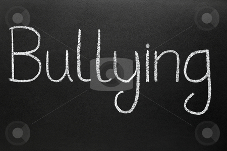 Bullying, written with white chalk on a blackboard. stock photo, Bullying, written with white chalk on a blackboard. by Stephen Rees