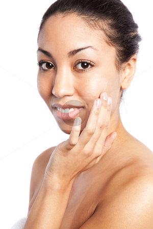 Beauty spa girl stock photo, An isolated shot of a beautiful black woman applying  lotion by Suprijono Suharjoto