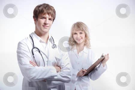Doctor and nurse stock photo, A shot of a caucasian doctor and nurse by Suprijono Suharjoto