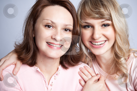 Mother and daughter stock photo, A portrait of a happy mother and daughter by Suprijono Suharjoto