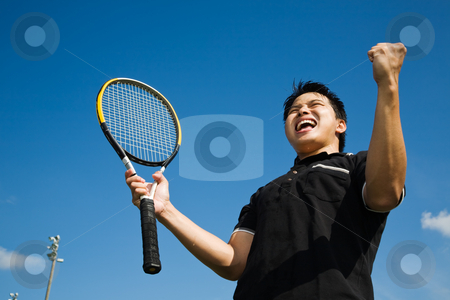 Asian tennis player joy in victory stock photo, A young sporty asian tennis player screaming in joy of victory by Suprijono Suharjoto