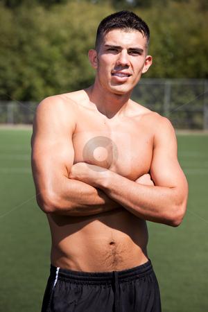 Hispanic soccer or football player stock photo, A shot of a hispanic soccer or football player by Suprijono Suharjoto