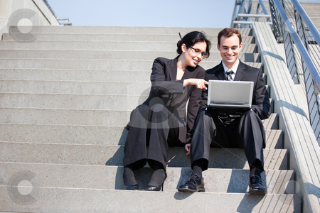Business people stock photo, A shot of two business people having a discussion outdoor by Suprijono Suharjoto