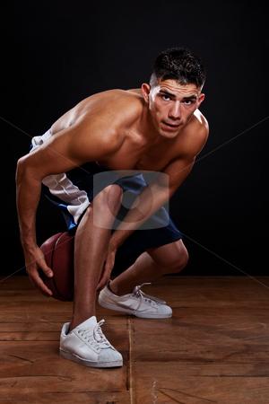 Hispanic basketball player stock photo, A portrait of a hispanic basketball player by Suprijono Suharjoto