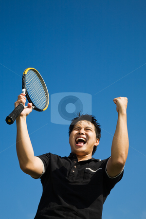 Asian tennis player joy of winning stock photo, A happy asian tennis player in joy of winning by Suprijono Suharjoto