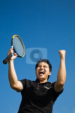 Asian tennis player joy of winning stock photo, A happy asian tennis player in joy of winning by Suprijono Suharjoto