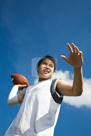 Asian football player stock photo, A young asian football player throwing a football by Suprijono Suharjoto