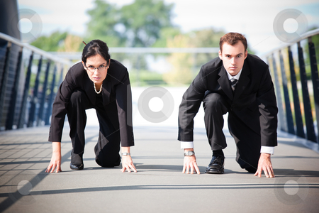 Business people in competition stock photo, A shot of two business people in a running start position competing against each other by Suprijono Suharjoto