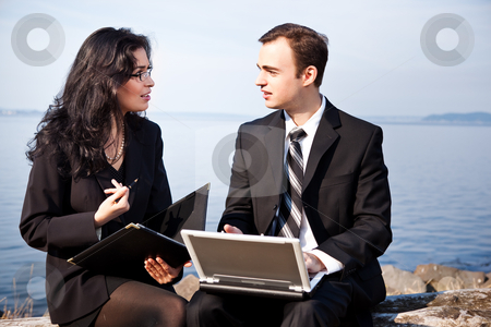 Working business people stock photo, A shot of two business colleagues working together outdoor by Suprijono Suharjoto