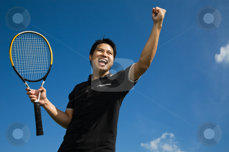 Asian tennis player in joy of victory stock photo, A young sporty asian tennis player screaming in joy of victory by Suprijono Suharjoto