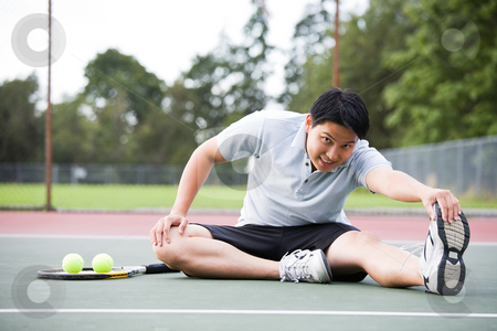 Asian tennis player stock photo, A young asian male tennis player stretching before playing by Suprijono Suharjoto