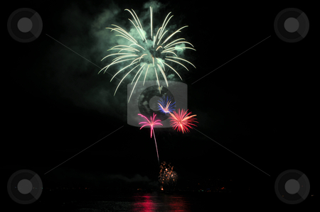 Smoke And Fireworks stock photo, Colorful nighttime fireworks against a solid black sky over Lake Tahoe on the fourth of July holiday 2010 by Lynn Bendickson