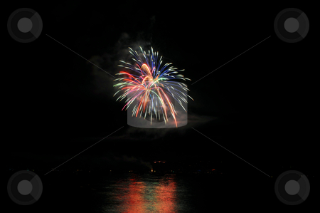 Fireworks And Reflected Colors stock photo, Colorful nighttime fireworks against a solid black sky over Lake Tahoe on the fourth of July holiday 2010 by Lynn Bendickson