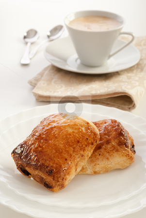 Pain au chocolat stock photo, Plate of pain au chocolat and cup of cappuccino by Mircea Savu