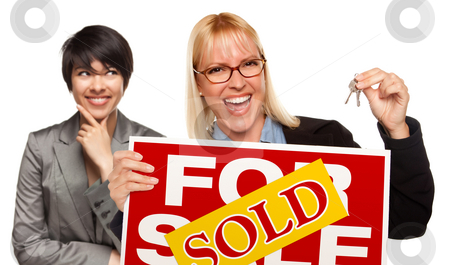 Female with Blonde Woman Holding Keys and Sold For Sale Sign stock photo, Hispanic Female Behind with Attractive Blonde in Front Holding Keys and Sold For Sale Sign Isolated on a White Background. by Andy Dean