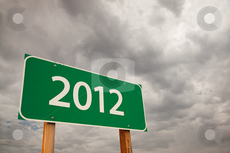2012 Green Road Sign Over Storm Clouds stock photo, 2012 Green Road Sign with Dramatic Storm Clouds and Sky. by Andy Dean