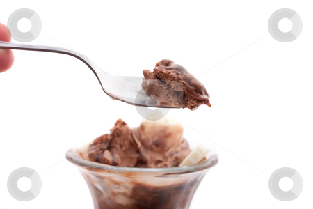 Chocolate Ice Cream Sundae stock photo, A delicious chocolate ice cream sundae with bananas isolated over a white background. Shallow depth of field.  Sharpest focus on the spoon. by Todd Arena
