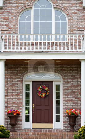 Luxury Home Entrance stock photo, The front entrance of a large custom built luxury home in a residential neighborhood. by Todd Arena