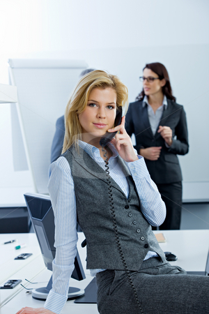 Business Woman stock photo, Woman talking on phone in conference room by Alexander Beck