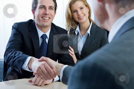 Business People stock photo, Businesspeople shaking hands at a meeting by Alexander Beck