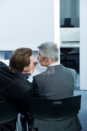 Business People stock photo, Business man wispering into colleagues ear by Alexander Beck