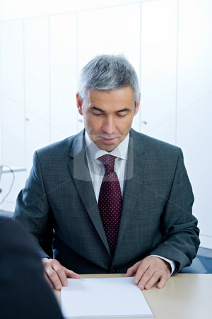 Business People stock photo, Business man looking at documents by Alexander Beck