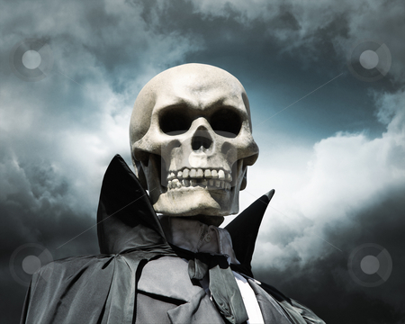 Grim reaper. death's skeleton on a cloudy dramatic sky stock photo, Grim reaper. death's skeleton on a cloudy dramatic sky by Laurent Davoust
