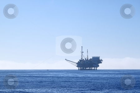 Oil rig stock photo, An offshore oil drilling platform near Ventura California by Henrik Lehnerer