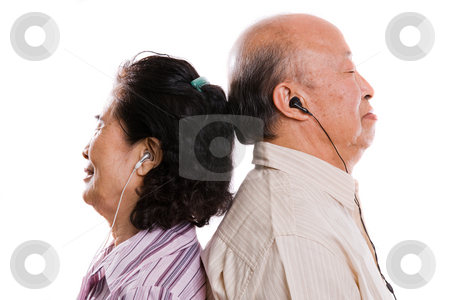 Senior asian couple listening to music stock photo, An isolated shot of a senior asian couple listening to music by Suprijono Suharjoto