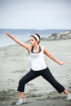 Yoga asian woman stock photo, A beautiful asian woman practices yoga at a beach by Suprijono Suharjoto