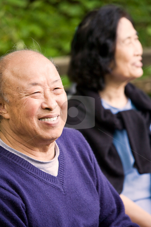 Happy elderly couple stock photo, A shot of happy elderly asian couple outdoor by Suprijono Suharjoto