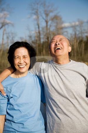 Happy senior couple stock photo, A shot of a senior couple having a good time outdoor by Suprijono Suharjoto