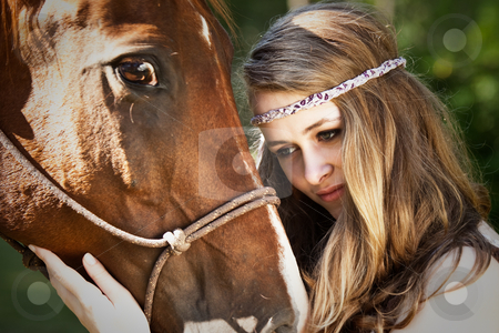 Girl with horse stock photo, A portrait of a caucasian girl with her horse by Suprijono Suharjoto