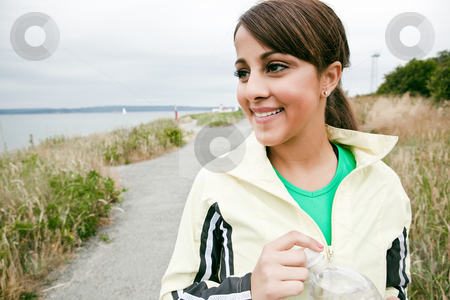 Sporty woman stock photo, A beautiful asian woman exercises in a park by Suprijono Suharjoto