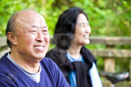 Happy senior asian couple stock photo, A shot of a couple of happy asian senior outdoor by Suprijono Suharjoto
