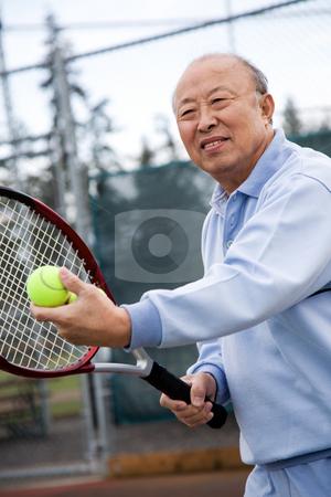 Senior tennis player stock photo, A shot of an senior asian man playing tennis by Suprijono Suharjoto