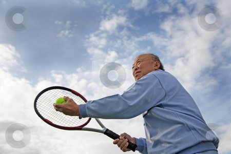 Senior tennis player stock photo, A shot of a senior asian man playing tennis by Suprijono Suharjoto