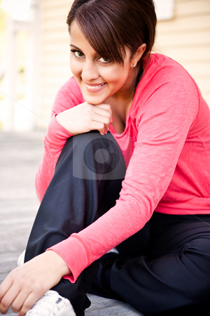 Beautiful sporty woman stock photo, A portrait  of a beautiful asian woman sitting after exercising by Suprijono Suharjoto