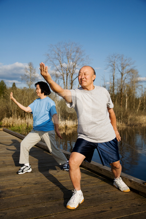 Senior exercise stock photo, A shot of a senior couple practicing tai-chi exercise by Suprijono Suharjoto