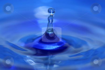 Water droplet splash stock photo, A blue water droplet splashing by Jim Mills