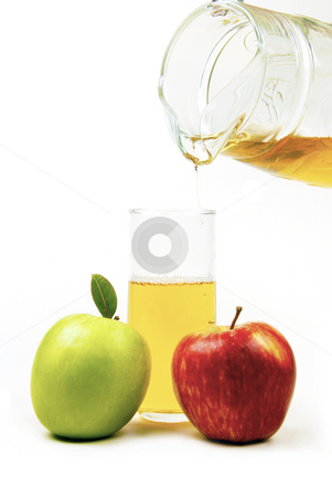 Fresh apple Juice stock photo, A glass of fresh apple juice with apples in the foreground by Mornay Van Vuuren