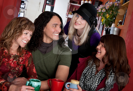 Four Good Friends stock photo, Couple with female friends at a bistro by Scott Griessel